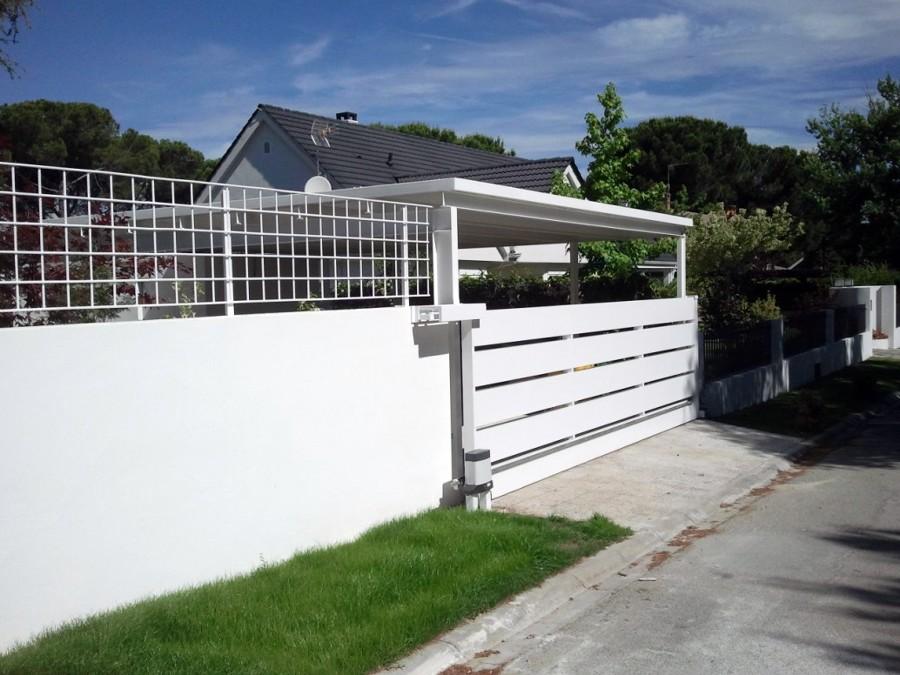 Puerta corredera para acceso garaje ideas carpinter a - Mecanismo puerta garaje ...