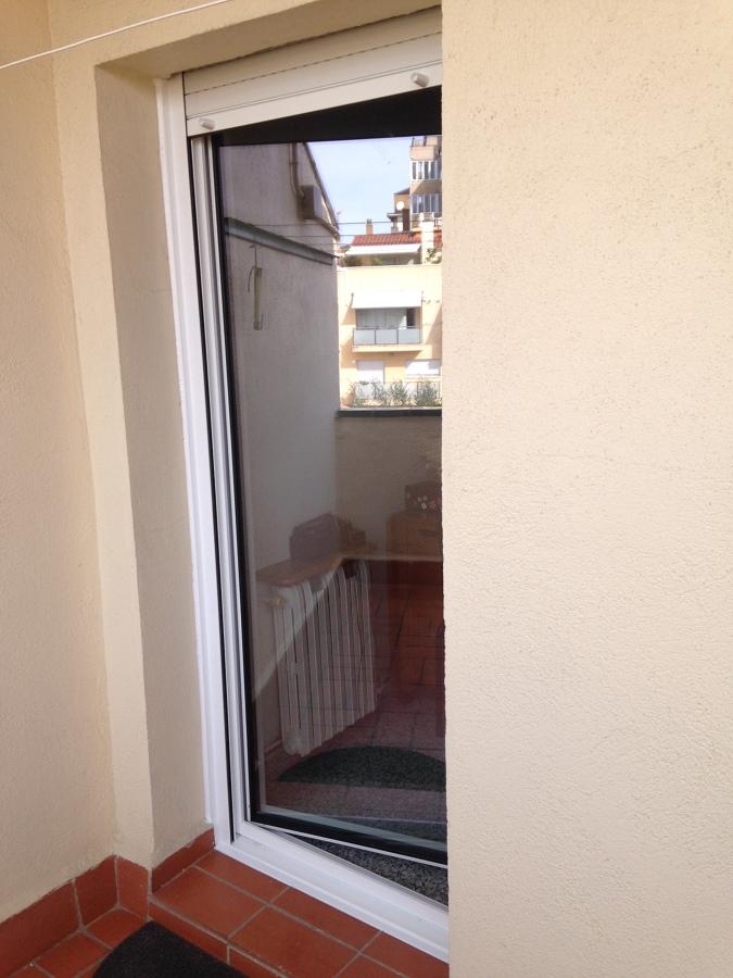 Instalaci n de ventanas rpt en casa en el centro de for Puerta lavadero