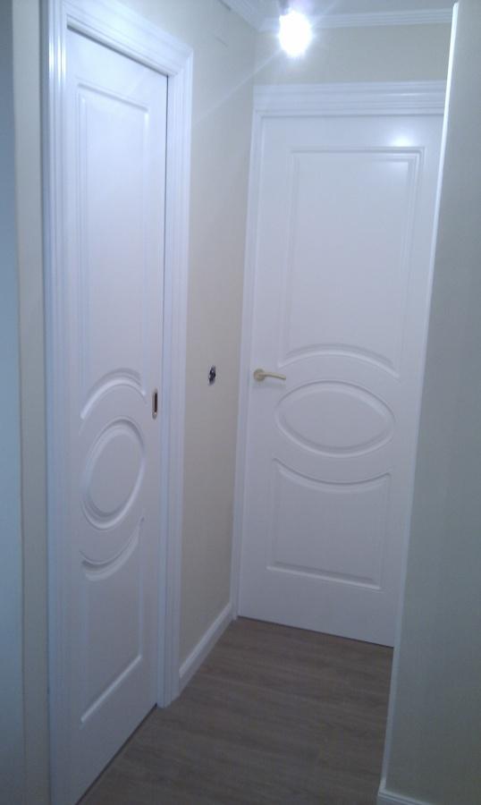 Instalaci n de tarima y puertas de paso en domicilio for Precio puertas de paso
