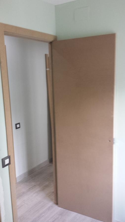 Puertas y armarios en dm ideas carpinteros for Puertas dm lacadas en blanco