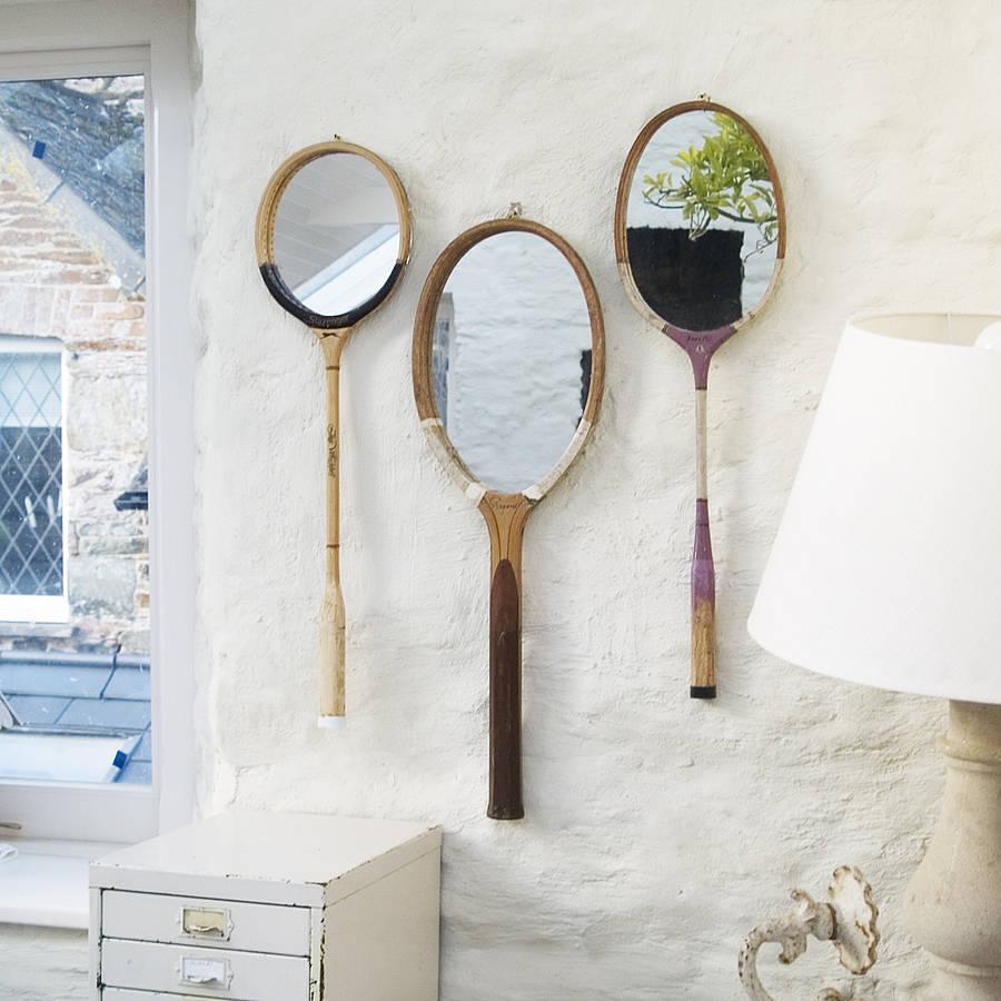 raquetas que se convierten en espejos de pared