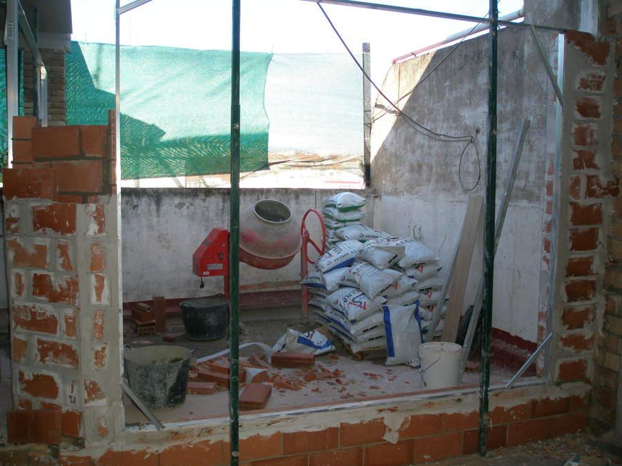 reconstruyendo la fachada para dos ventanales