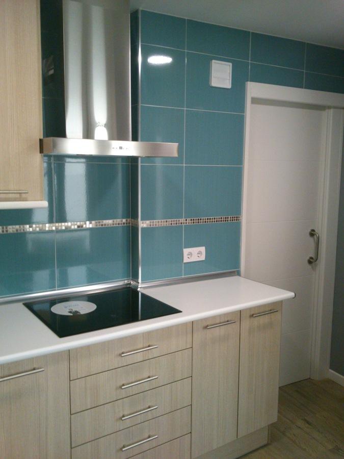 reforma cocina con puerta corredera  con doble tabique