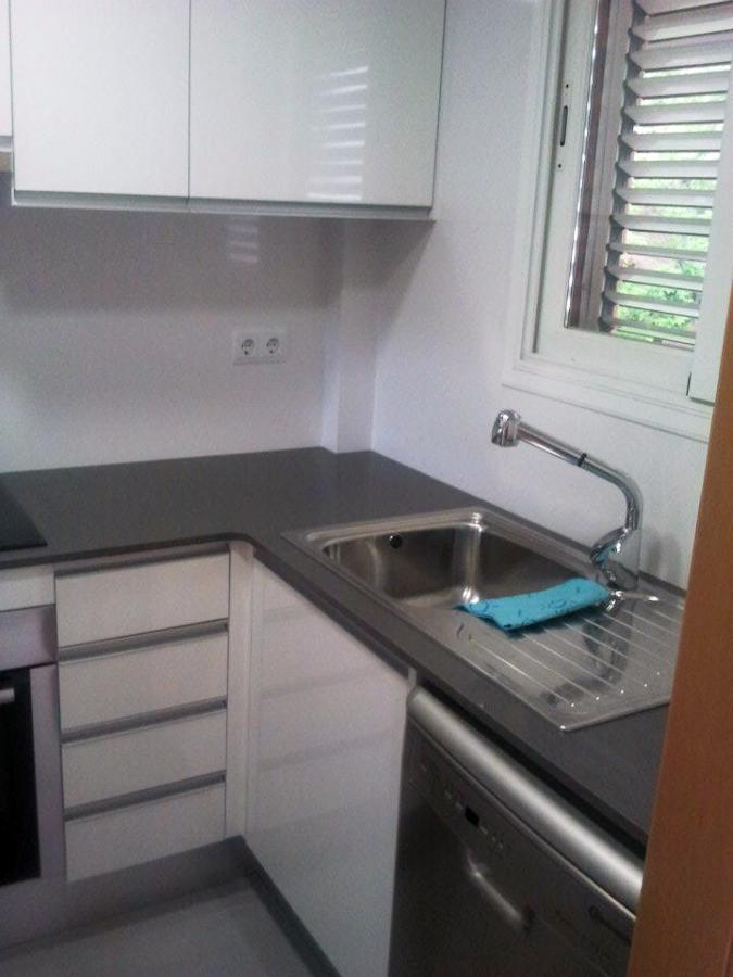Foto reforma integral de un piso puertas parquet for Accesorios para interiores de armarios de cocina