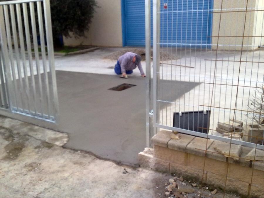 Reparacion de pavimento y valla