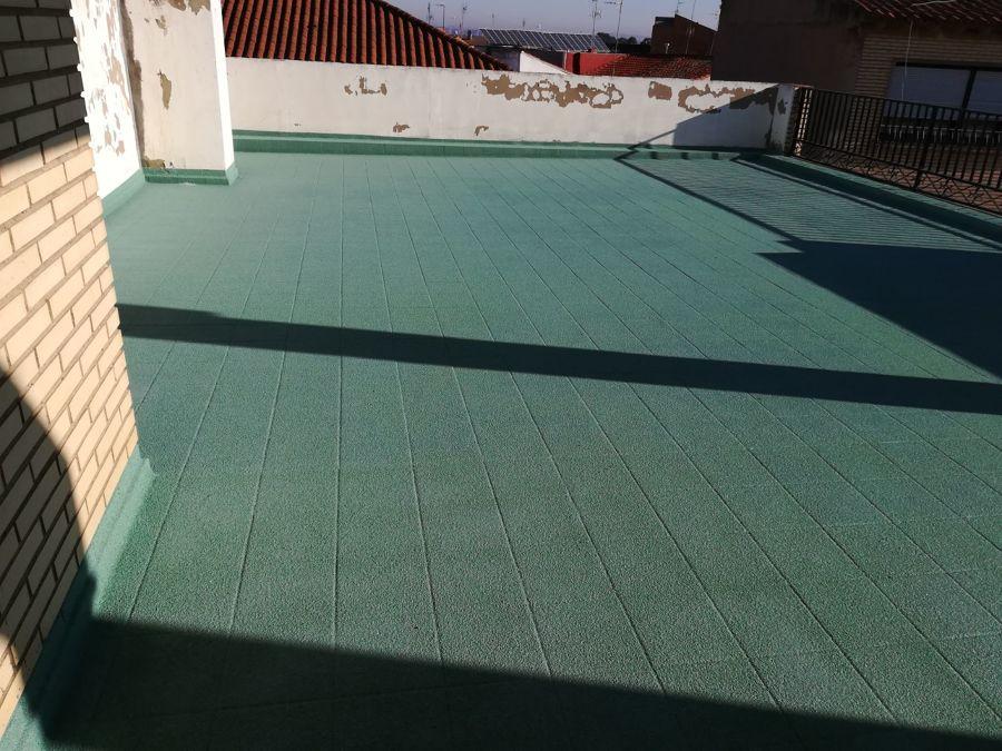 Revestimiento de terraza con cuarzo proyectado