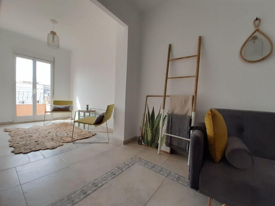 Sacar paredes para ampliar espacios y ganar luz natural