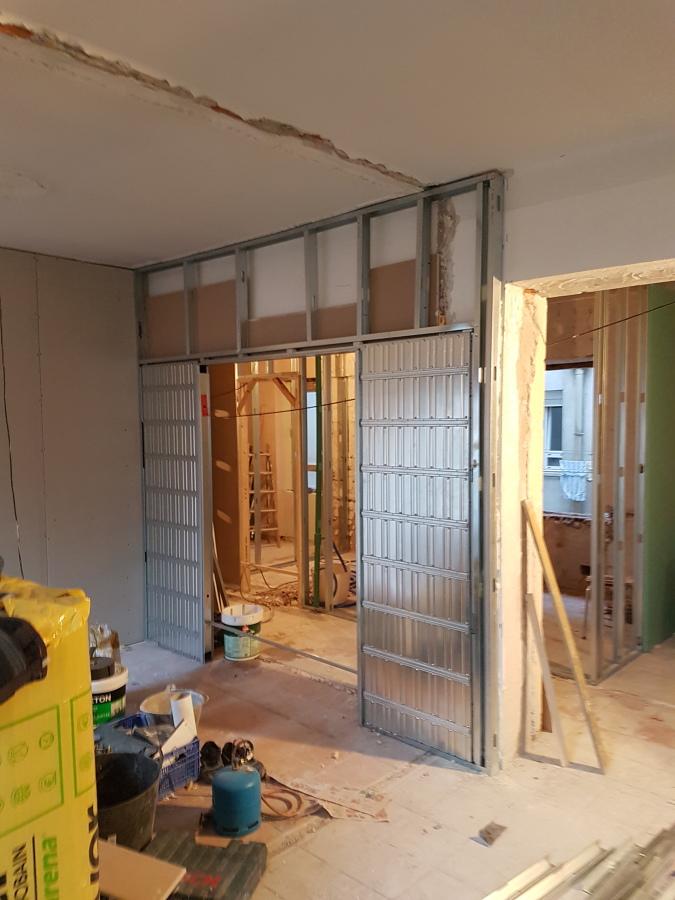 Salón con puerta Corredera doble
