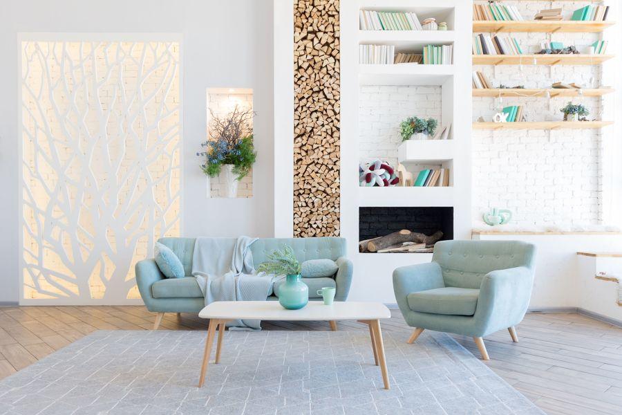 Salón de estilo moderno y sofás en azul agua