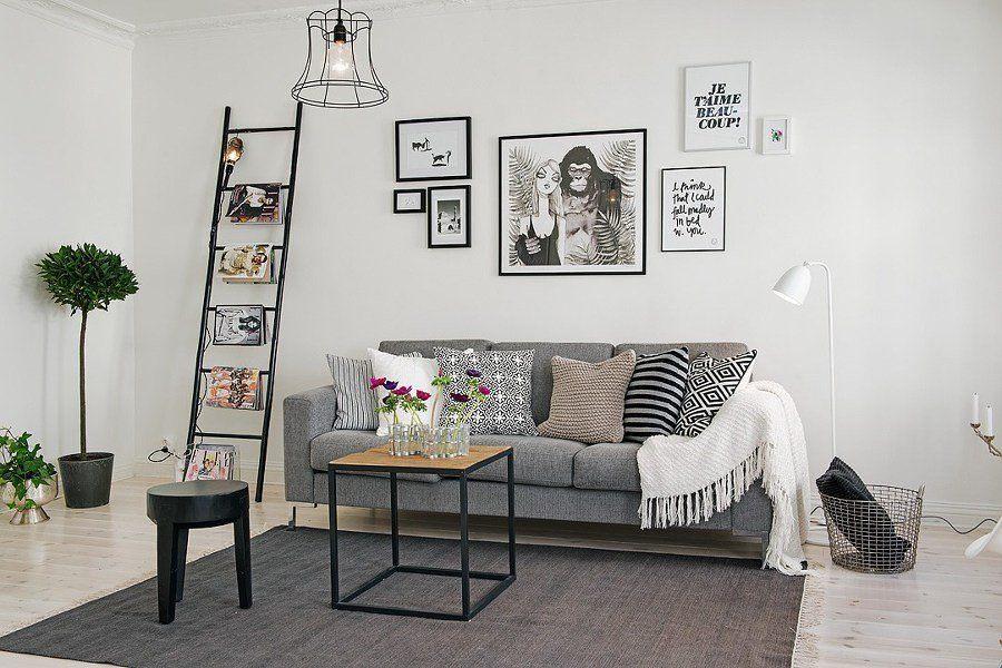 Salón de estilo nórdico y sofá gris