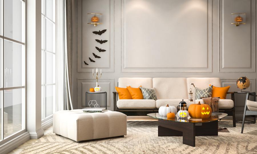 salón decorado para halloween con calabazas y murciélagos