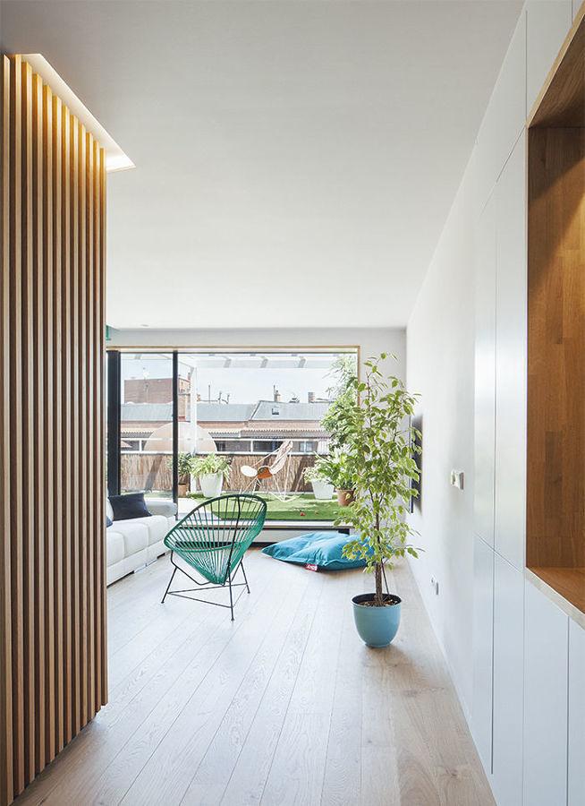 salón diáfano con terraza