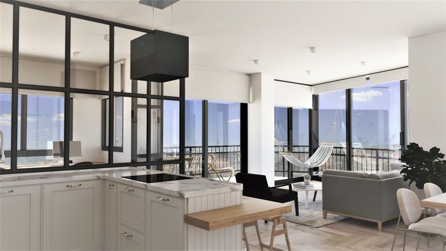 Salón y cocina en concepto abierto con vistas panorámicas
