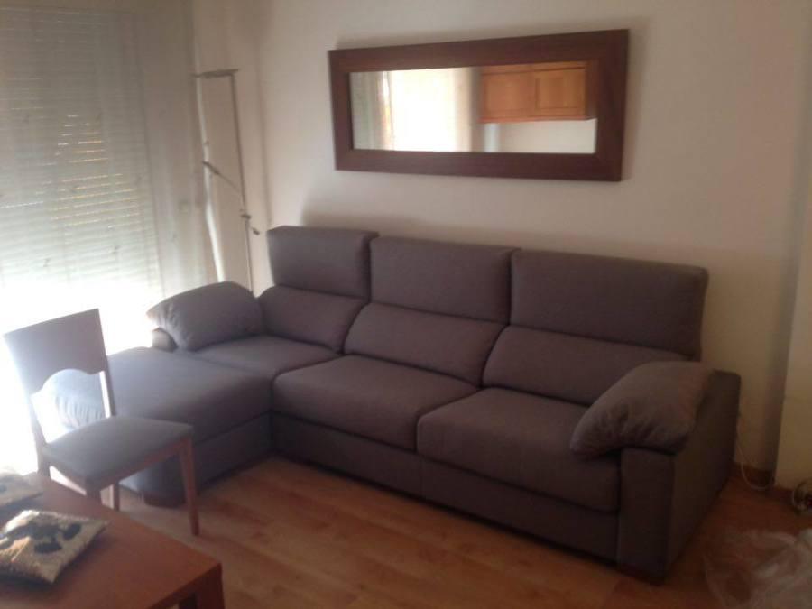 Sofá, puff y silla