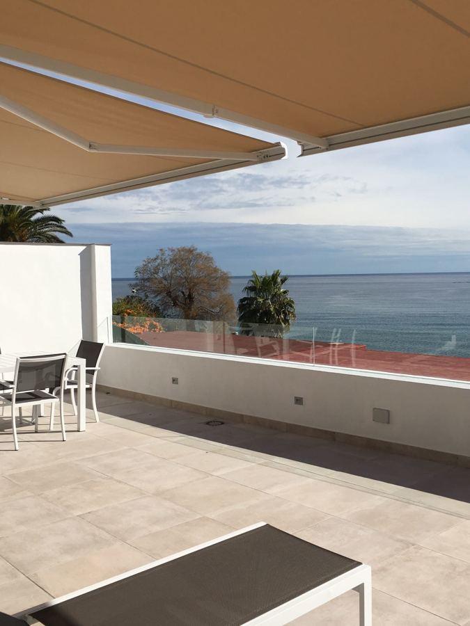 Solado terraza y barandilla acristalada