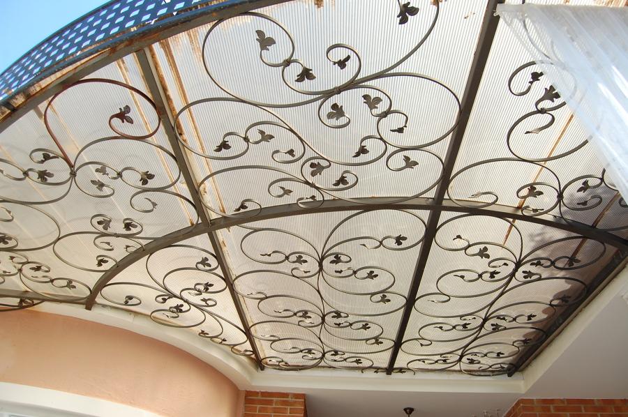 techo de cristal y forja