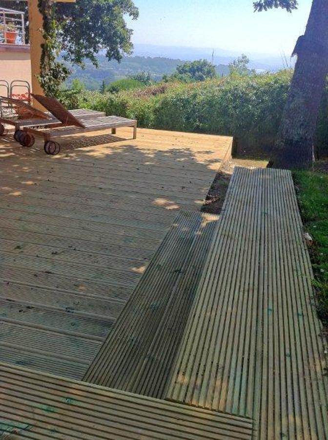 Terraza de madera ideas construcci n casas for Construccion de casas en terrazas