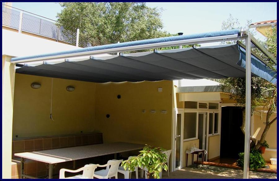 Foto toldo plegable de ondas de tendals tecnics 638360 for Carriles de aluminio para toldos