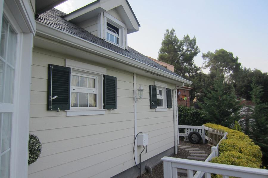 Foto trasera casa de carpenter house construcci n de for Casas de madera estilo americano