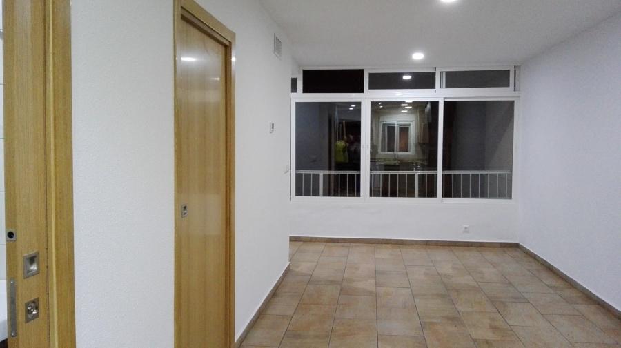 Unificación de salón con balcón