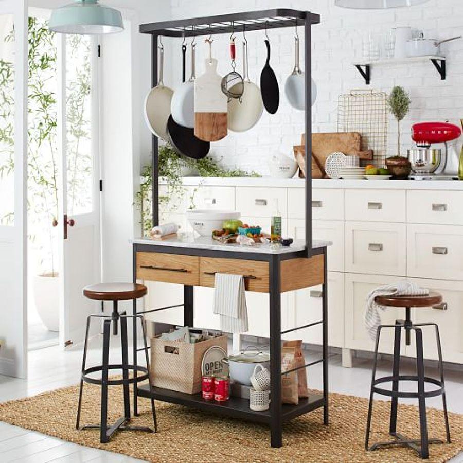 Trucos para tener tu cocina ordenada ideas decoradores for Colgar utensilios de cocina
