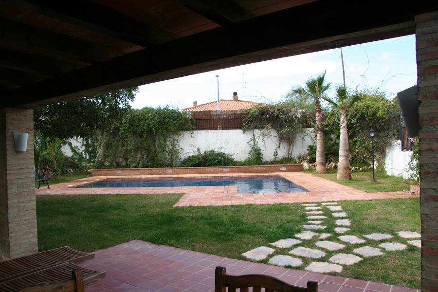 vistas de la piscina desde el porche