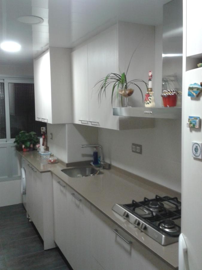 zona de lavadora y caldera integrada en cocina
