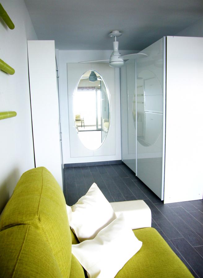 Zona de vestidor y camas literas