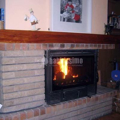 Chimenea insertable aplicada en antigua chimenea de hogar abierto (Barcelona) MODELO PANORAMA 25V