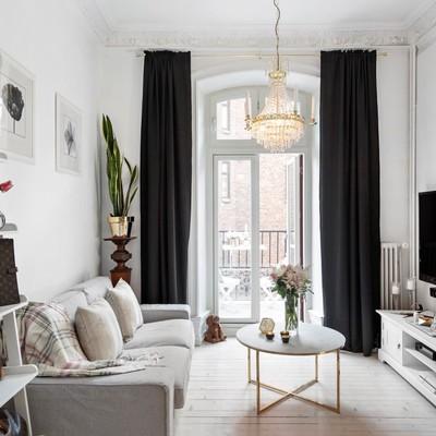 Un apartamento chic: blanco, negro y dorado