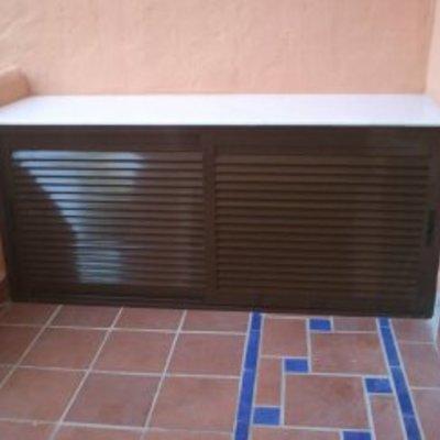 armario para cubrir maquina de aire acondicionado.