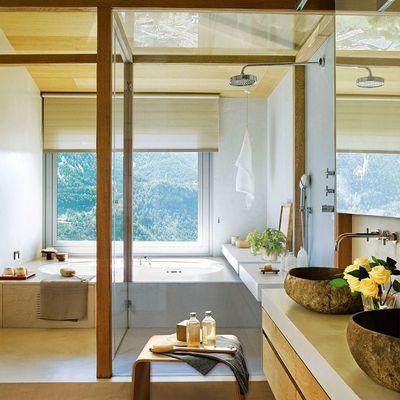 Baño con dos lavabos de piedra