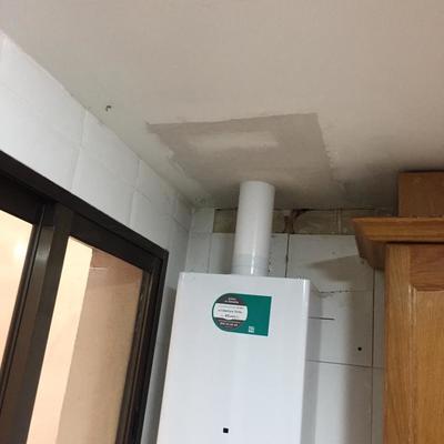 Instalacion calentador con cierre de escayola