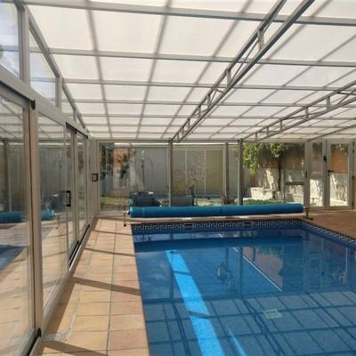 Cerramiento de piscina en carpintería de aluminio