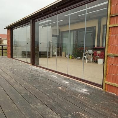 Cambio de correderas de madera por cortinas de cristal