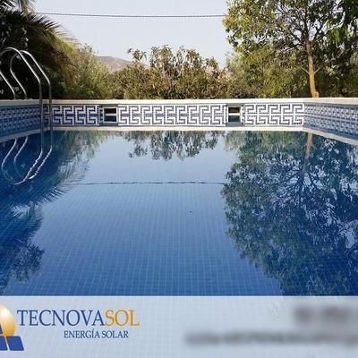 Instalación solar térmica para ACS y calefacción por suelo radiante con apoyo de insertable de leña