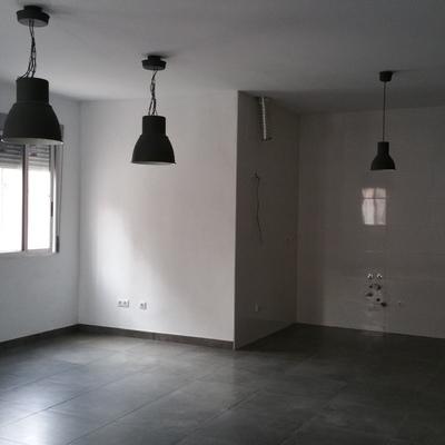 Ampliación de vivienda sobre almacén existente