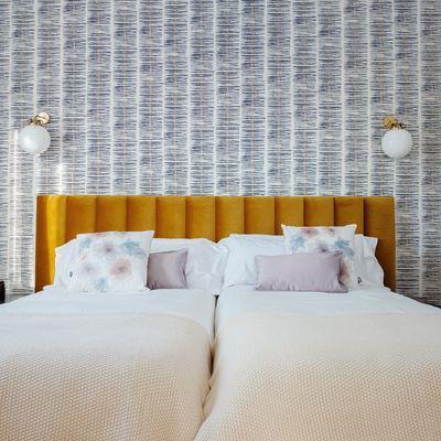 ¿Con qué puedo decorar las paredes de mi dormitorio?