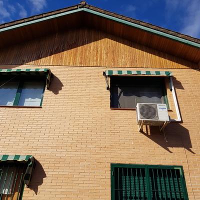 Revestimiento de fachada con aislamiento térmico.