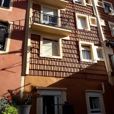 Rehabilitación de fachada revestida de teja cerámica