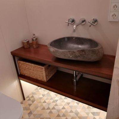 grifos empotrado con lavabo de piedra