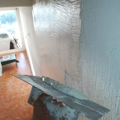 Alisado de paredes con gotele y luego aplicación de pintura