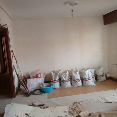 Lucido y pintado de vivienda