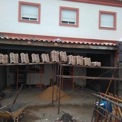 Construcción de medianeras entre vecinos y porche