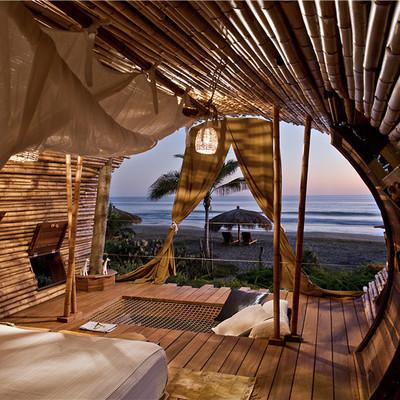dormitorio casa de árbol hecha de bambú