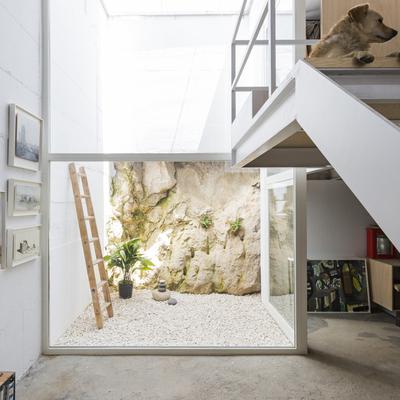 Patio pared de piedra