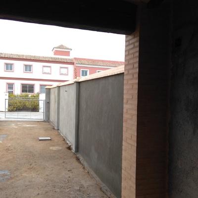 Construcción de medianeras con vecino y porche
