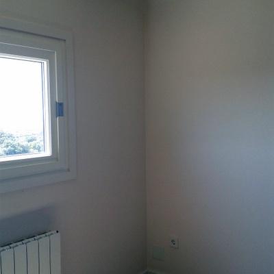 Pintado e instalación del parquet.