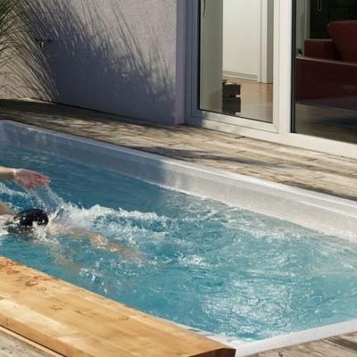 Cómo tener una piscina olímpica en casa (o algo que se le parezca)
