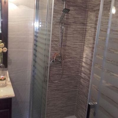 Plato de ducha con la mampara